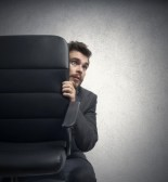 23909539-concept-of-fear-of-a-businessman-behind-a-chair