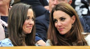 Britain's Catherine, Duchess of Cambridge sits with her sister Pippa Middleton on Centre Court at the Wimbledon Tennis Championships in London