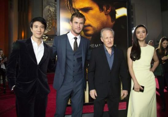 Director of the movie Mann poses with cast members Wang, Hemsworth and Tang at the premiere of